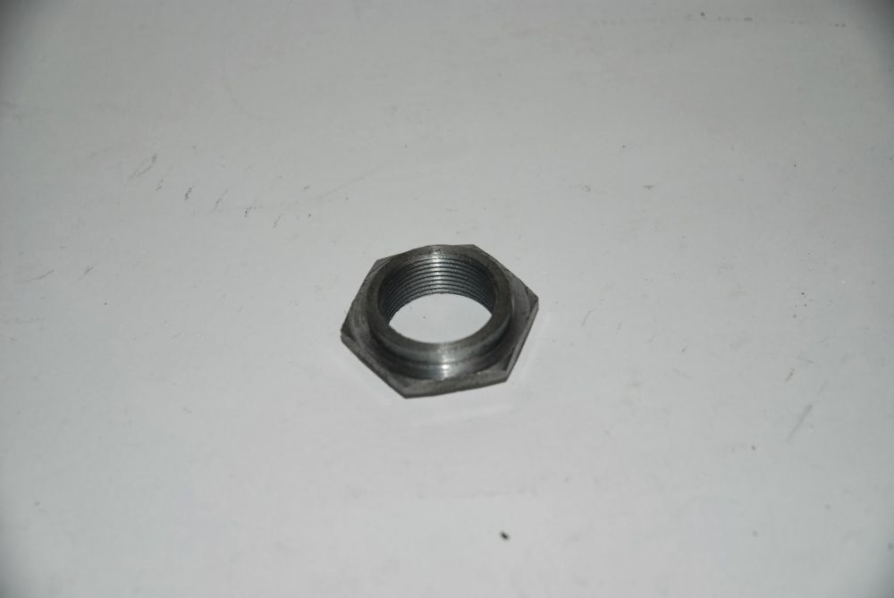 nut fixing the head bearing of the frame